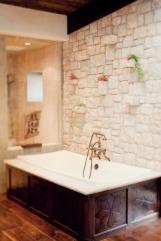 stone-and-wood-paneled-tub